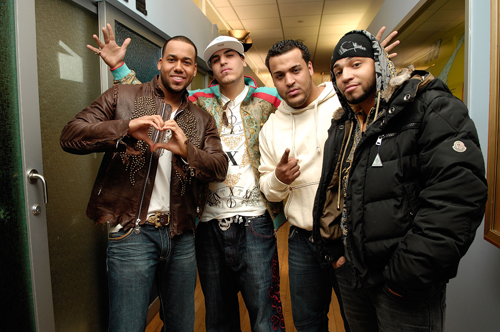 """NEW YORK - FEBRUARY 12:  Anthony Santos, Max Santos, Leny Santos and Henry Santos Jeter of the bachata band Aventura pose for pictures after visiting """"Mi TRL""""  at  MTV Studios Times Square on February 12, 2008 in New York City.  (Photo by Gary Gershoff/WireImage)"""