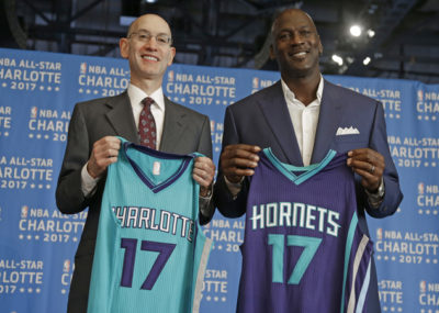 FILE - In this June 23, 2015, file photo, NBA commissioner Adam Silver, left, and Charlotte Hornets owner Michael Jordan, right, pose for a photo during a news conference to announce Charlotte, N.C., as the site of the 2017 NBA All-Star basketball game. The NBA is moving the 2017 All-Star Game out of Charlotte because of its objections to a North Carolina law that limits anti-discrimination protections for lesbian, gay and transgender people, Thursday, July 21, 2016. (AP Photo/Chuck Burton, File)