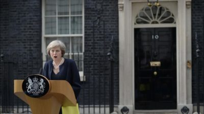 Britain s new Prime Minister Theresa May speaks outside 10 Downing Street in central London on July 13 2016 on the day she takes office following the formal resignation of David Cameron Theresa May took office as Britain s second female prime minister on July 13 charged with guiding the UK out of the European Union after a deeply devisive referendum campaign ended with Britain voting to leave and David Cameron resigning AFP PHOTO OLI SCARFF