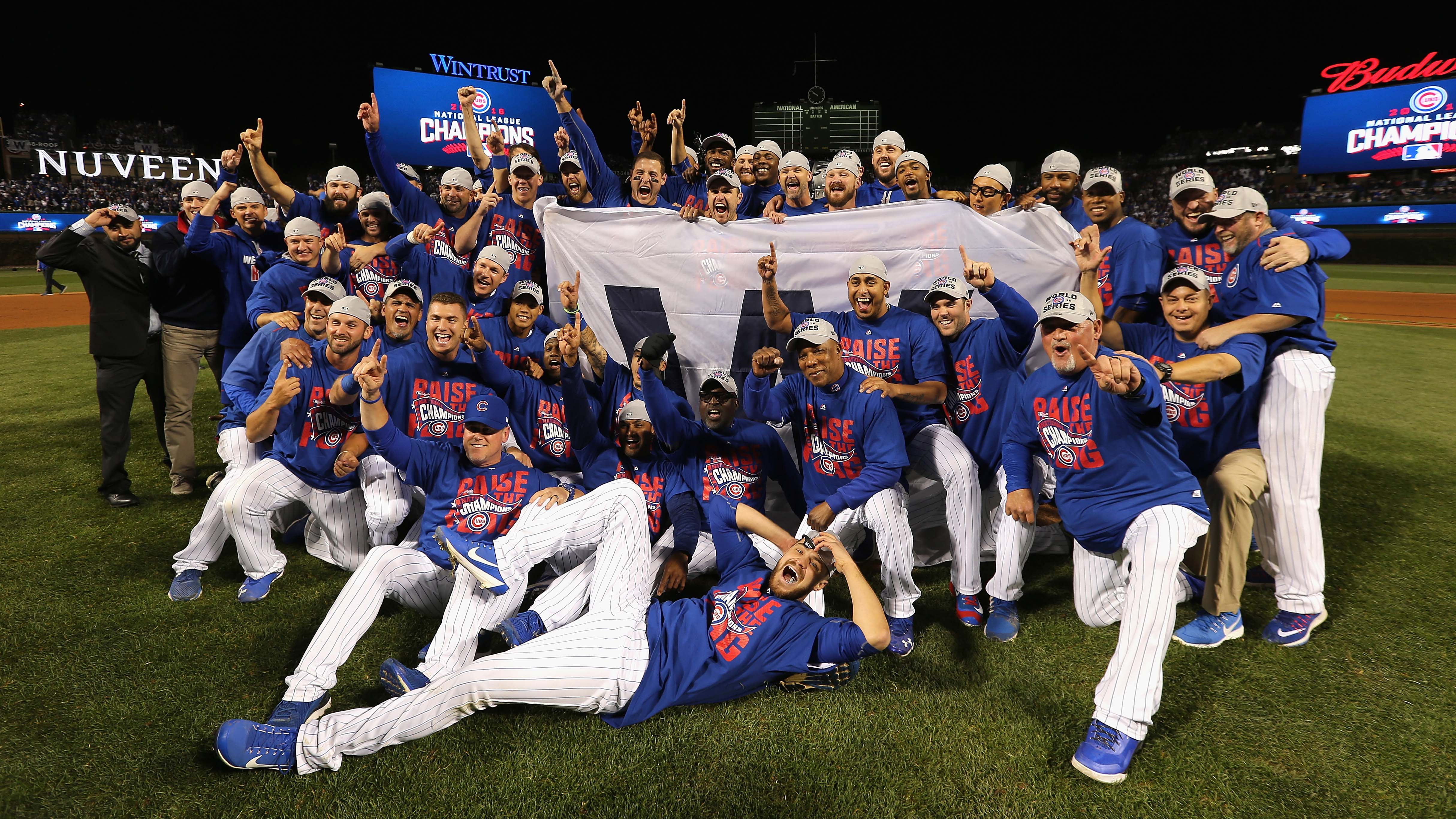 CHICAGO, IL - OCTOBER 22: The Chicago Cubs pose after defeating the Los Angeles Dodgers 5-0 in game six of the National League Championship Series to advance to the World Series against the Cleveland Indians at Wrigley Field on October 22, 2016 in Chicago, Illinois. (Photo by Jonathan Daniel/Getty Images)